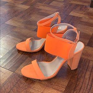 Neon orange heels